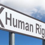 "road sign with ""human rights"" written on it"