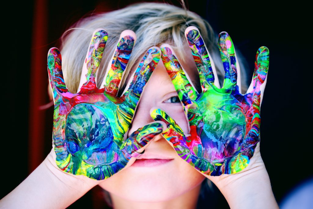 kid with paint hands